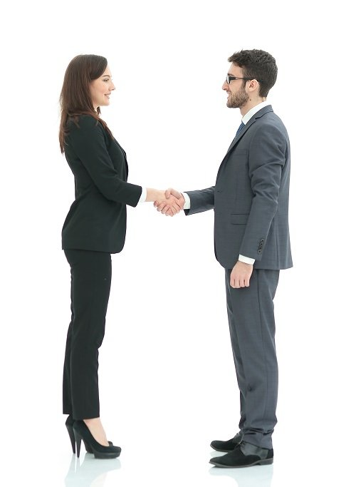 Image of two young managers discussing ideas at meeting
